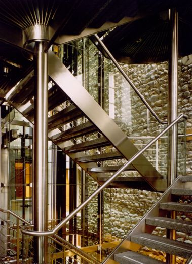 Iconic steel staircase against preserved medieval walls at the Widder Hotel Zurich, by architect Tilla Theus