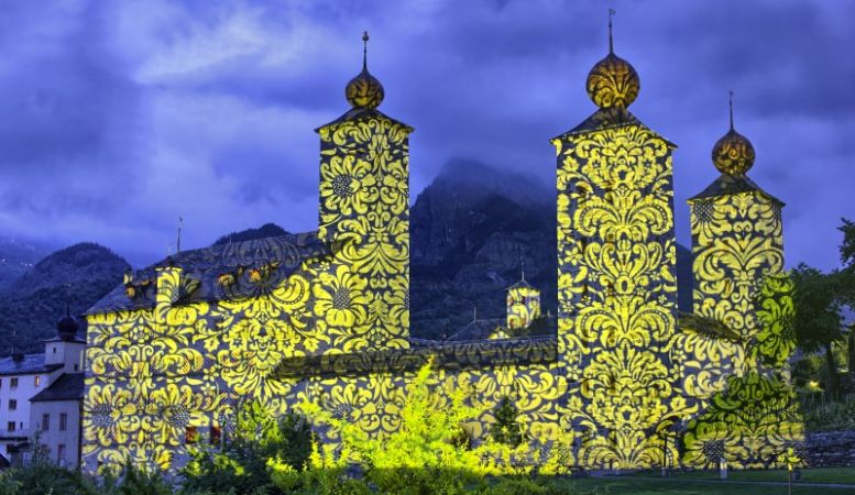 Brig, Switzerland, art, Valais, castle lit up with artwork in the mountains