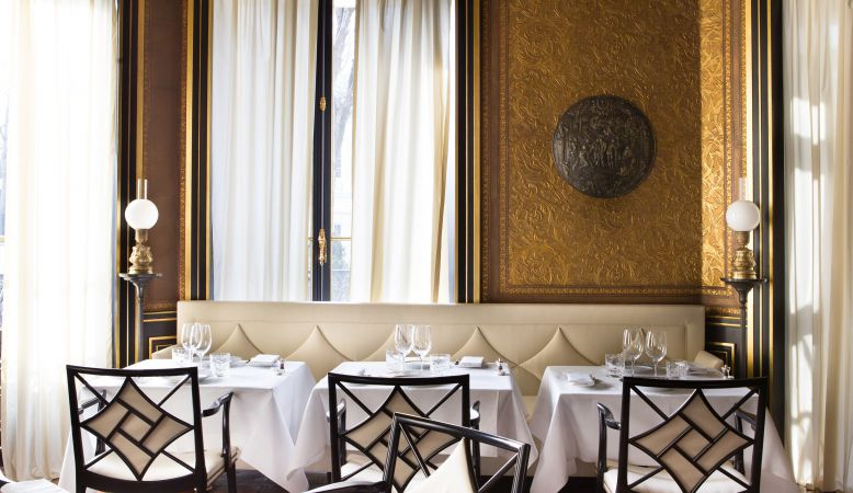 La Gabriel Restaurant Paris at La Reserve Hotel interiors designed by Jacques Garcia in gilded golden wallpaper
