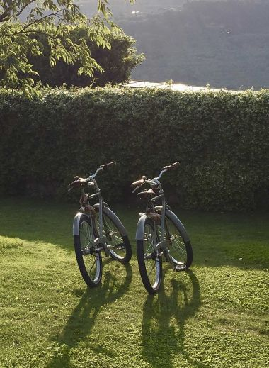 Cycles for hire Vivere Suites Hotel - perfect to explore nearby Lake Garda - two bikes in the sun waiting