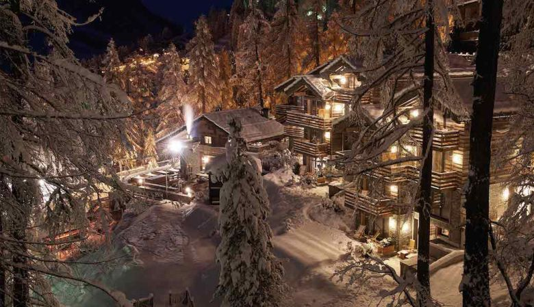 Cervo ski resort through the trees at night, lit up and lively