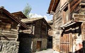 old-fashioned architecture of small village hamlets found in the Alps, wooden beams and stones make up the building