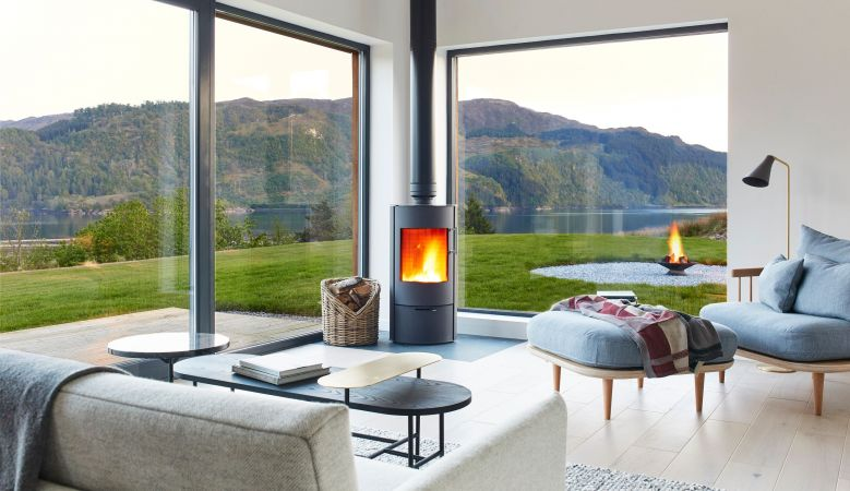 Comtemporary fireplace | Designer Interiors of this modern Scottish holiday home called 57 Nord in Wester Ross, Highlands Scotland