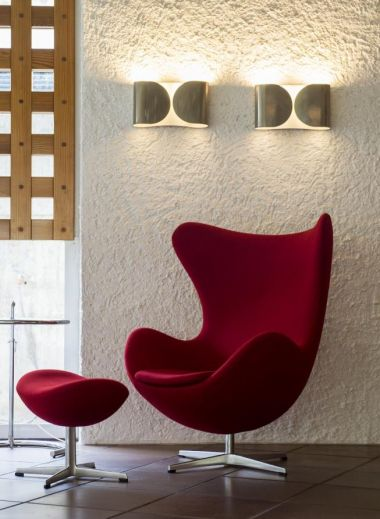 Bucket chair in scarlette red at the seventies Seehotel Ambach in Caldaro/Kaltern South Tyrol Italy