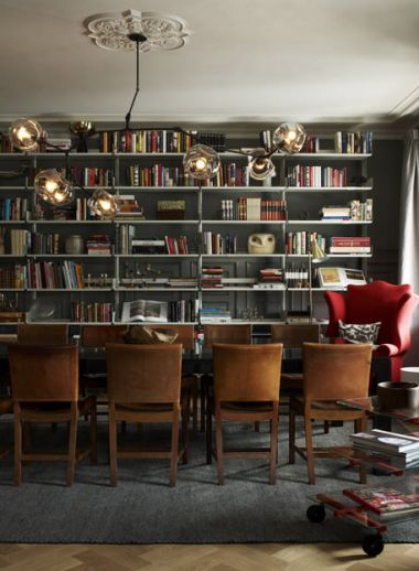 Library, contemporary mid-century furninshingsby Ilse Crawford at the Ett hem Hotel