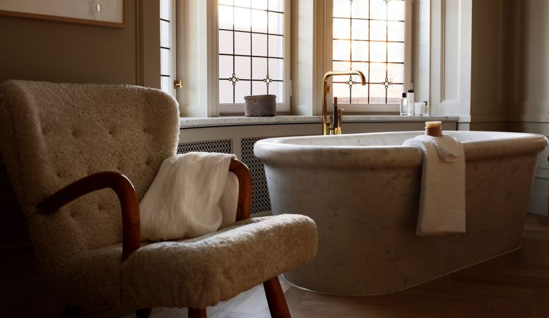 Marble bathtub - total luxury of a suite at Stockholm's Ett Hem Hotel desgined by Ilse Crawford