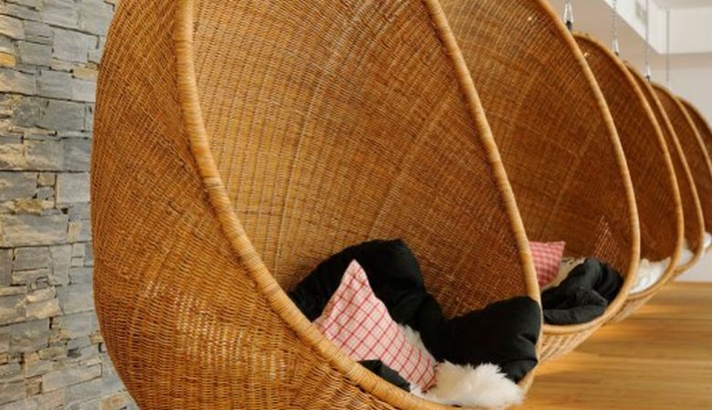 Hanging wicker chairs, relax, chill, spa, at the design Hotel Hubertus Alpin Lodge and Spa in the Allgäu Mountains, Germany