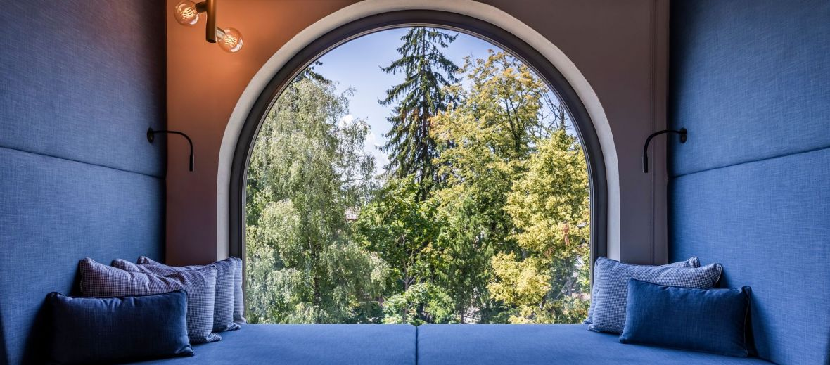 Gloriette Boutique Hotel Soprabolzano - Arched windows cased in blue cotton in South Tyrol designed by noa architects, overlooking the Dolomites