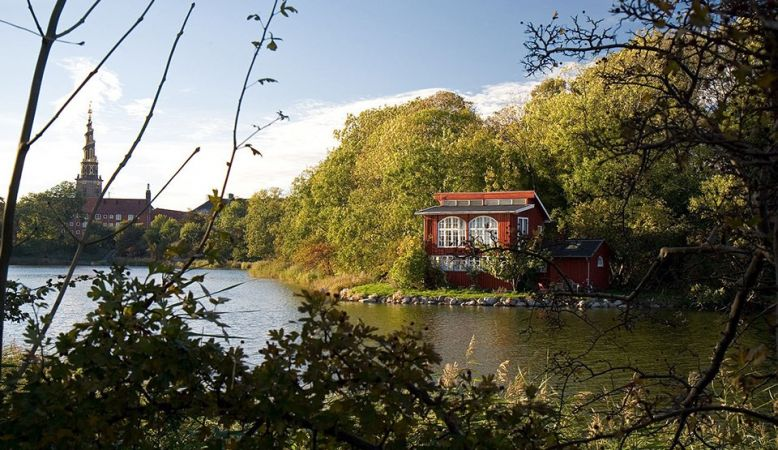 A red house on the side of the lake in Copenhagen's free town Christiania