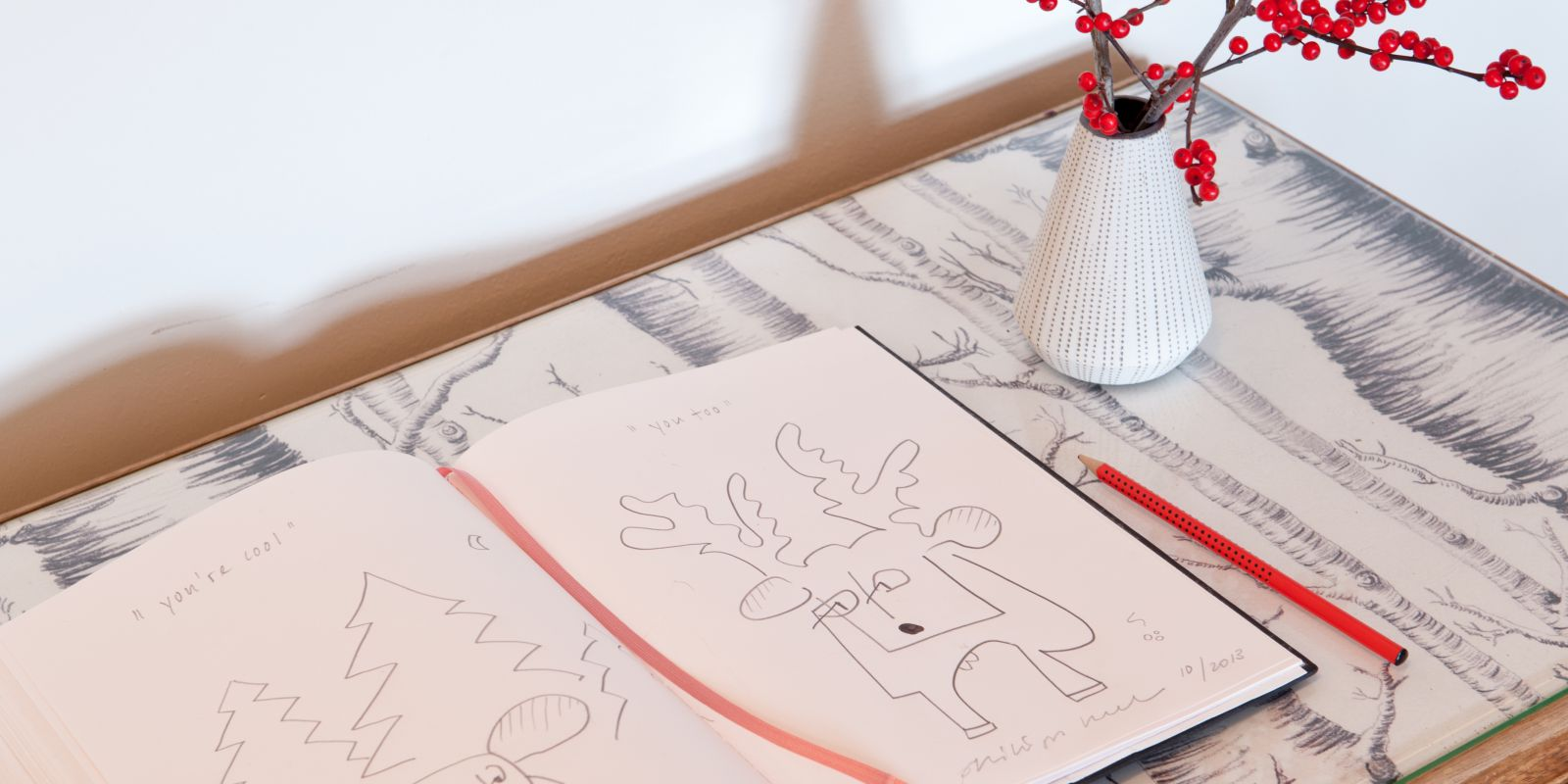 Creative hotel guest book with drawing about a stay, culture travel and art, little details