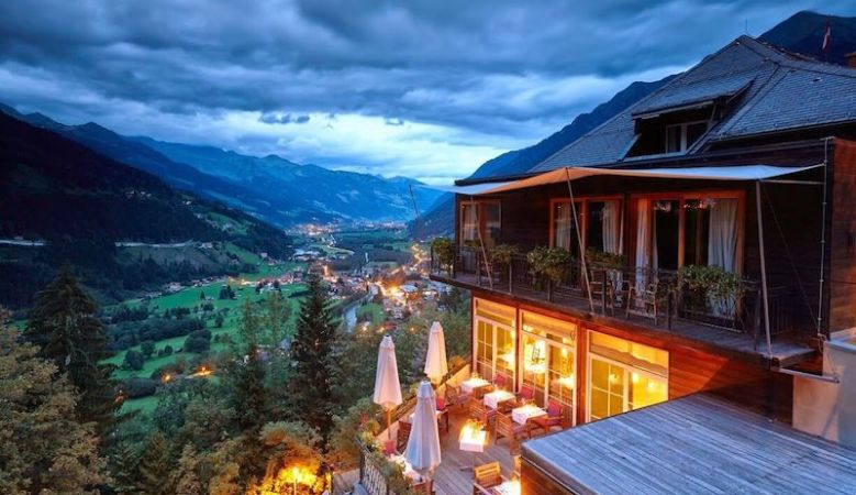 View from the outside overlooking the Bad Gasteiner Valley at sunset, the Haus Hirt Boutique Alpine Hotel & Aveda Spa in Bad Gastein, Austria