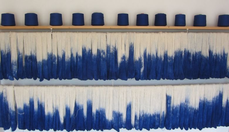 Looms of IKAT - IKAT Blue & white textile from Mallorca, that bears a characteristic pattern obtained by the process of resist dying, and the island of Mallorca is the only place where you can still visit family-run workshops that have been operating for