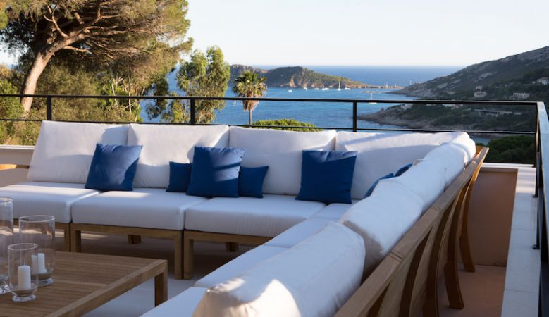 Designer Al fresco lounge seating overlooking the gardens of La Reserve from the Villas