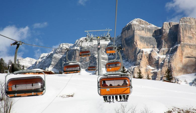 Ski lift cabins in Alta Badia, heading up to the Dolomites, South Tyrol, Italy