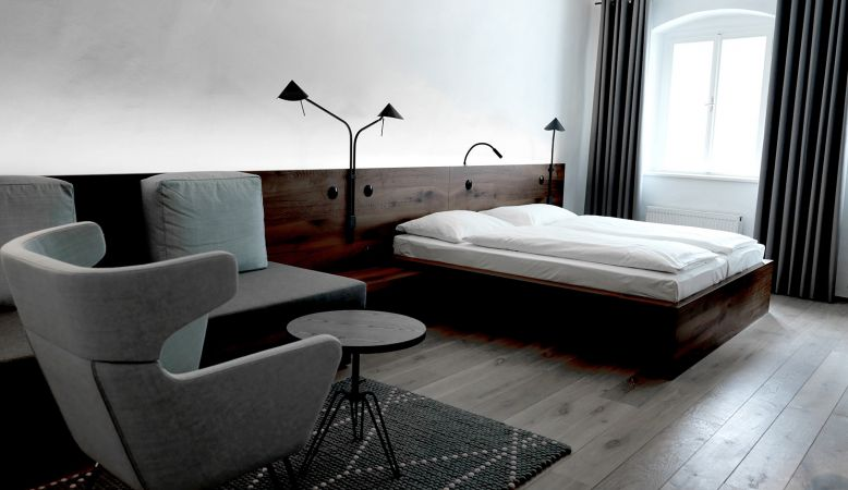 Creatively designed bedrooms of aged walls and modern interior at the Blaue Gans Hotel, Salzburg