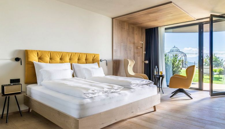 Modern Alpine Bedroom Interior - Gloriette Boutique Hotel Soprabolzano - designed by noa architects, overlooking the Dolomites in South Tyrol, Italy
