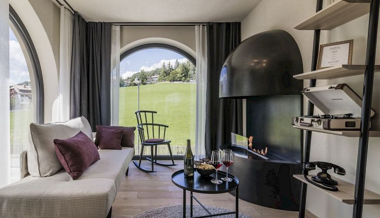 Gloriette Boutique Hotel Soprabolzano - Designer Suite Bedroom with arched windows designed by noa architects, overlooking the Dolomites in South Tyrol, Italy