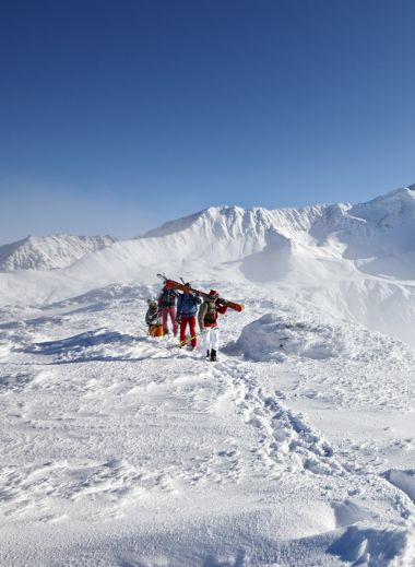 skiers on the Haute Route trek look at the snowy mountains