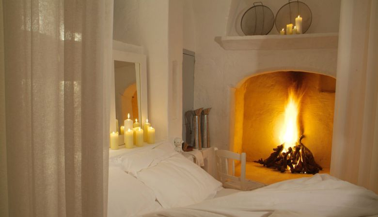 Romantic bedrooms with fireplace - Masseria Cimino in Puglia, Italy - a boutique interior