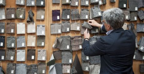 A man looking at samples of Moessmer wool, a famed luxury product in South Tyrol