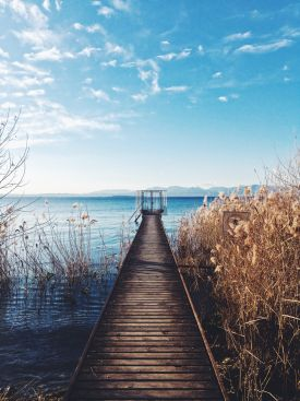 Lake Garda Italy | planked walkway to the lake, swimming in the blue lake