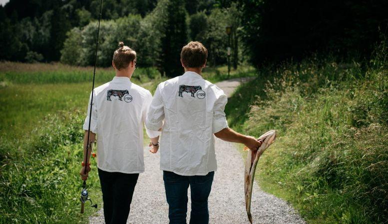 Chefs of the organic restaurant HECHT go to catch fresh trout from Der Seehof Hotel in Goldegg, Austria , fresh fish for dinner