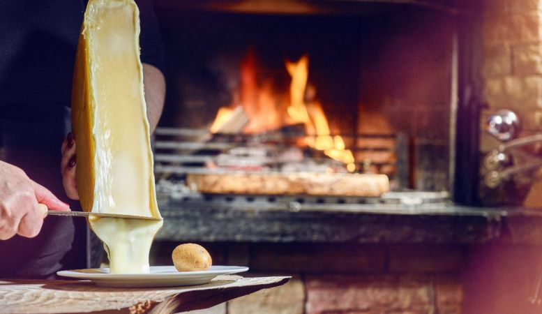 raclette on the fire in Valais, Switzerland, culture