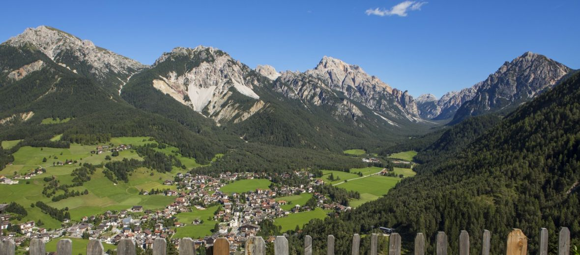 Photo of San Vigilio di Marebbe, the green valley and Dolomites