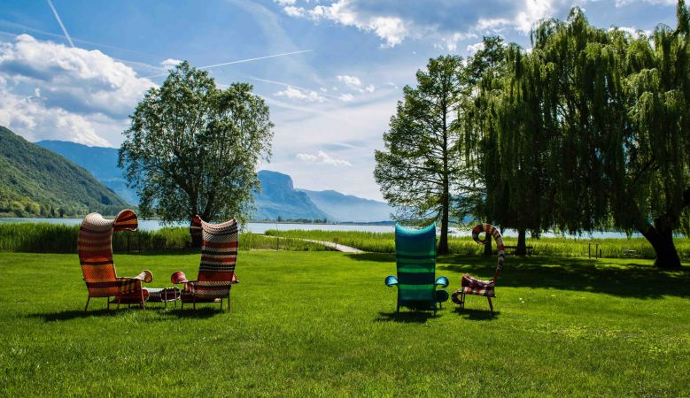 Shoreline gardens sun loungers at the seventies Seehotel Ambach in Caldaro/Kaltern South Tyrol Italy
