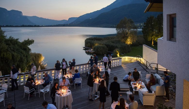 Sunset bar and restaurant overlooking the lakes at the seventies Seehotel Ambach in Caldaro/Kaltern South Tyrol Italy