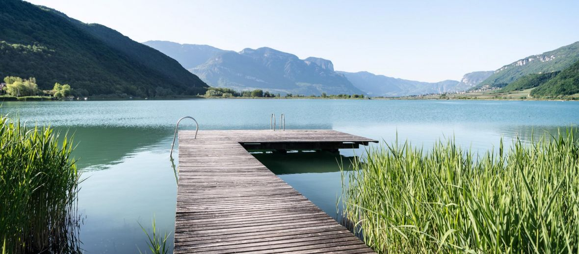 Lake Caldaro with wooden pier jetty from the Seehotel Ambach in Caldaro/Kaltern South Tyrol Italy