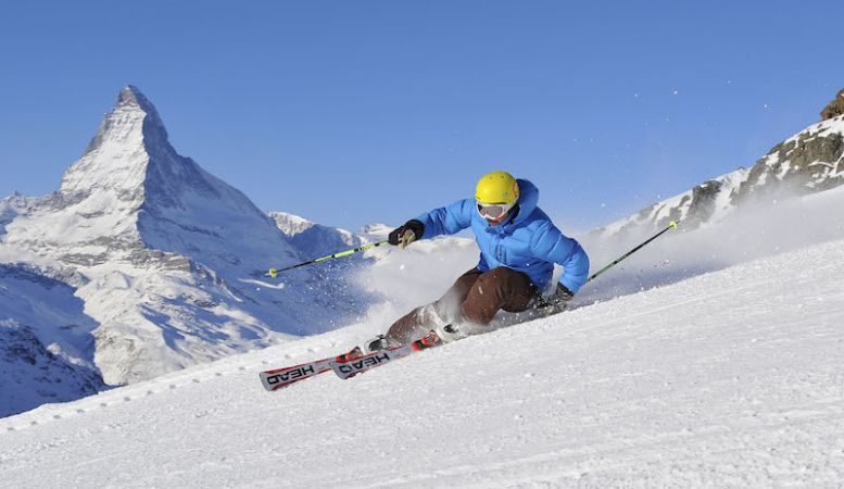 Photo of skier with the Matterhorn as backdrop, Zermatt Skiiing, snow, white