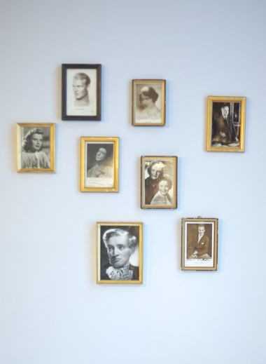 A photograph of the frames hanging on Hotel Altstadt Vienna's room 65's wall, as designed by interior designer Roland Nemetz