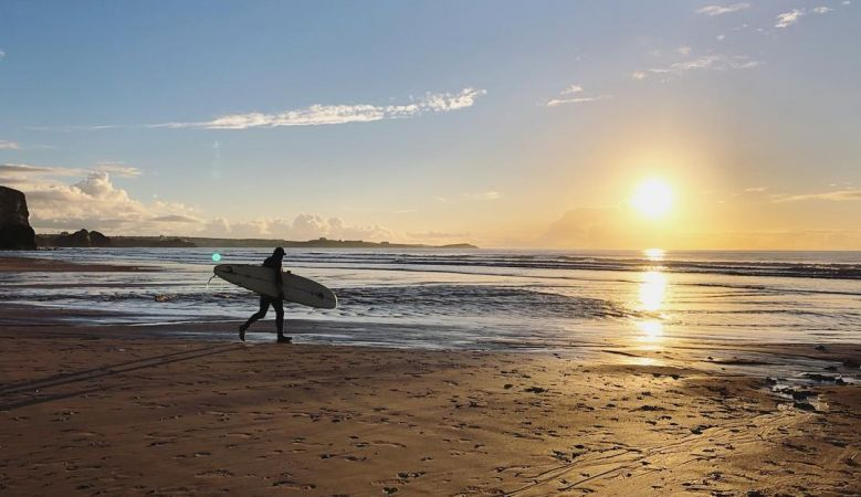 Surfers at sunset, Watergate Bay Beach North Cornwall, England, coast, sports, surfers, surf, surfing,