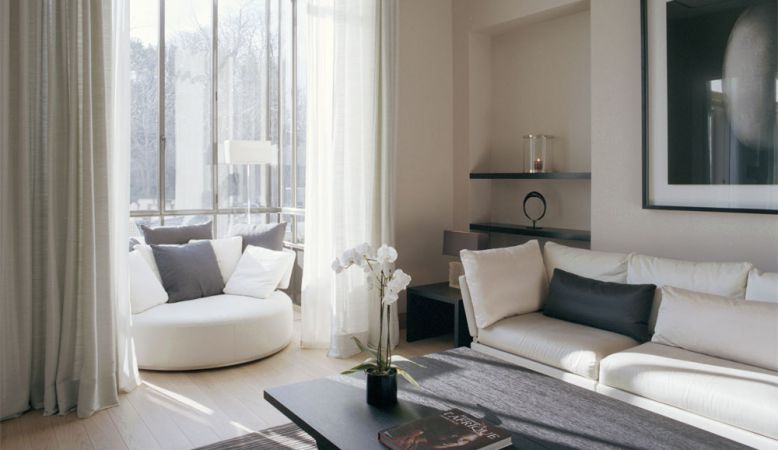 Designer lounge overlooking the Eiffel Tower - Luxury Serviced Apartments by La Reserve Paris, modern contemporary interior