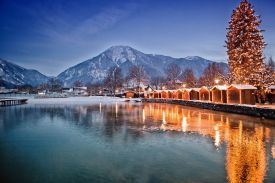 Bavaria's famous lakeside Christmas market in Tegernsee, a shot of the lake with twinkling lights and Christmas huts