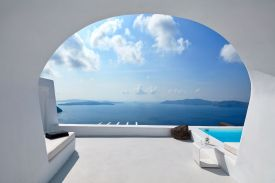 Luxury Villa Charissa Santorini designed in white, view to the Caldera from Aenaon Villas, white architecture view of Aegean, Designed by Elly Alexiou (Architect) and Maria-Christina Alexiou