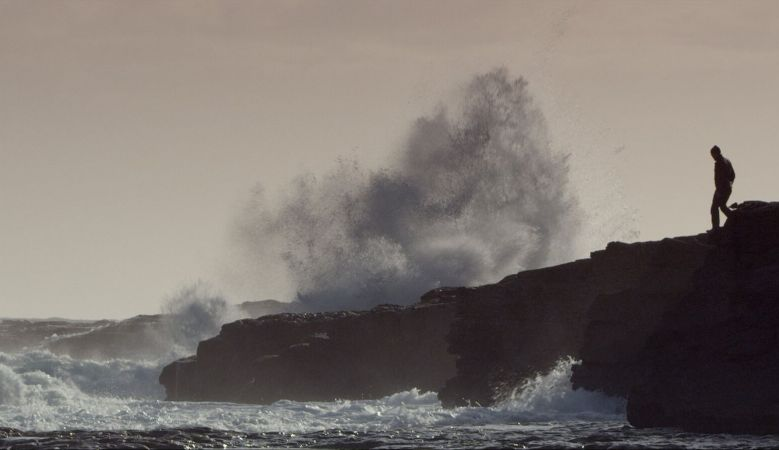 The rough seas on Inis Meáin in the Aran Islands, Ireland, waves crashing against the cliffs
