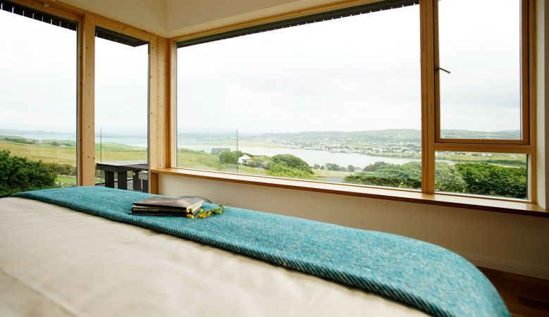 Views from Breac. House - Bed throw in Atlantic blues made by Eddie Doherty, handwoven Irish tweed, in Donegal, Ireland