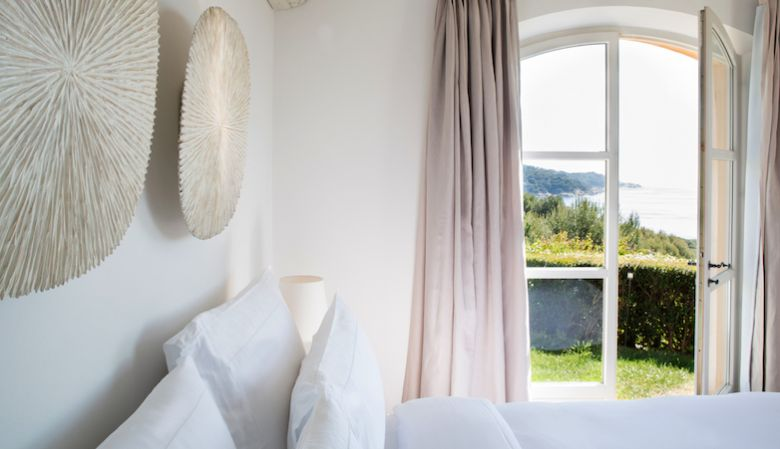 White master bedroom of La Reserve luxury villa on the French Riviera for rent