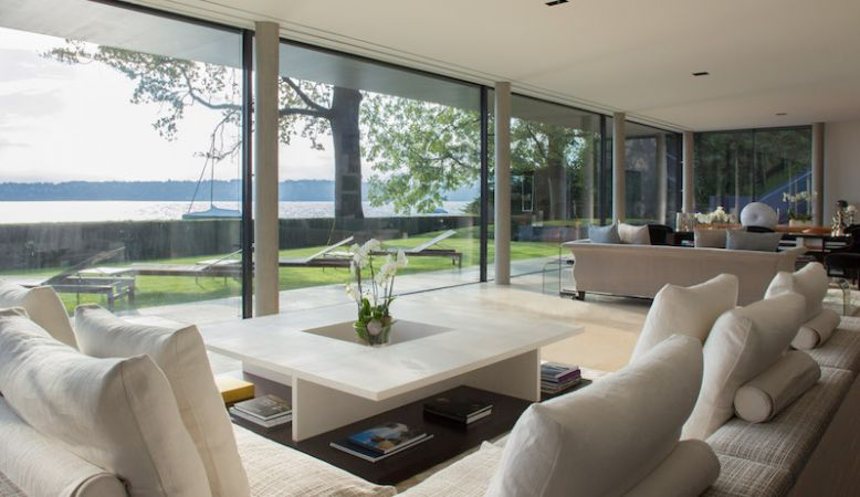Fabulous modernist luxury living room of the Villa du Lac - a rental private ville in Geneva designed by Rémi Tessier