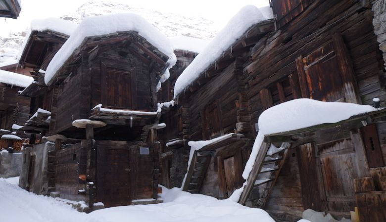 Old town charm of Alpine houses in Zermatt covered in snow, chololate box chalets