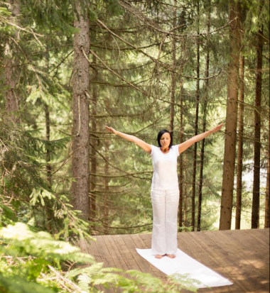 Open air Yoga in the forest at Design Hotel Forsthofgut & Spa, Leogang, Austria
