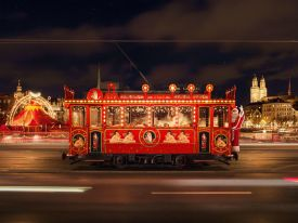 A red, festive Christmas train carrying children around the city and to Santa in Zurich, Switzerland