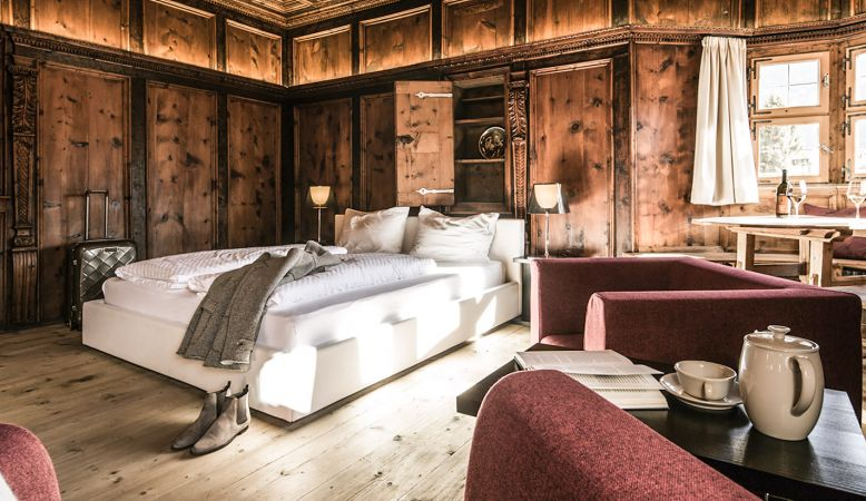 Alpine Suites at Boutique hotel Weisses Kreuz & Mansion zum Löwen is a design and Spa hotel in Burgeis (Burgusio), situated in the Venosta Valley (Vinschgau), South Tyrol, Italy.