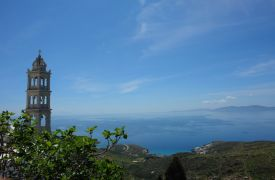 Tinos in Greece, church tower, sea, blue sky