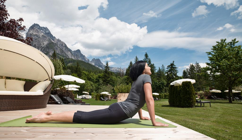 Outdoor excercise at the Yoga retreat - Design Hotel Forsthofgut & Spa, Leogang, Austria